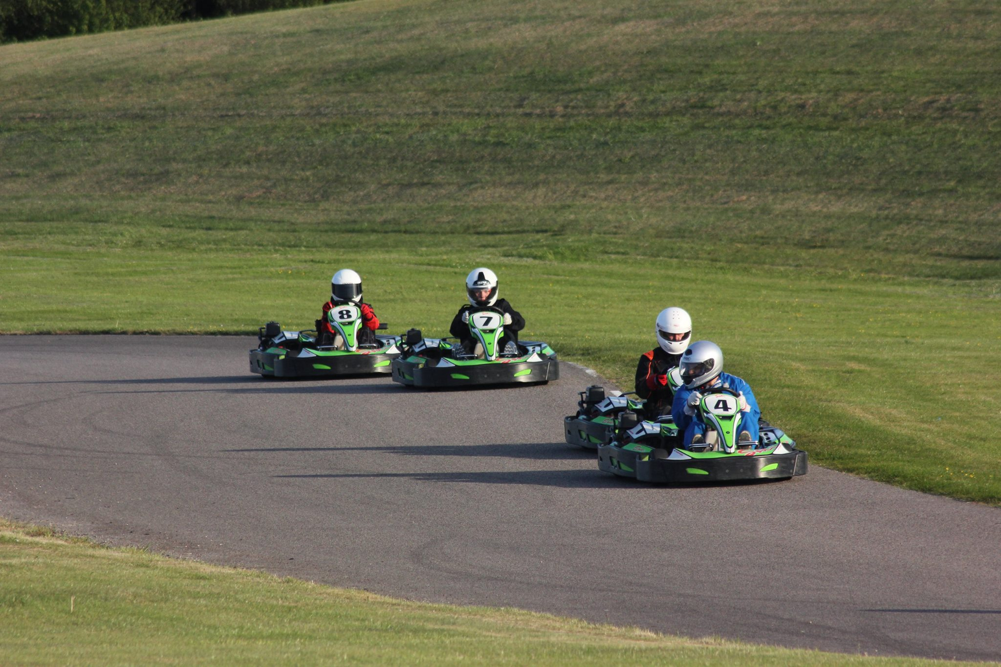 Go Karting Racing down the Back Straight at Sutton Circuit in Leicestershire
